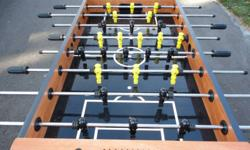 Foosball Table in excellent condition.  Made by Harvard. Has cup holders at both ends; includes 3 balls.  Paid $600 new asking $325.  Looking to sell as need the space.