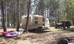 This camper is a Trail Lite, meaning lighter towing capacity. Here are the perks! a MUST SEE!!! - 23 foot - towing weight (empty) 2200 kg - VERY CLEAN, and EXCELLENT condition.. owned by non-smokers - sleeps 4 ( 5 if one of them is a child) - Lots of