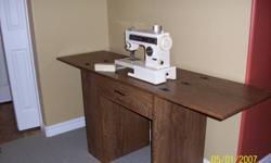 For Sale Kenmore Ultra 10 sewing machine with cabinet (has 2 side storage shelves), comes with manual and accessories.  Used very little, excellent condition. $150.00 firm. Serious enquiries only!