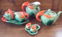 I have for sale an antique Majolica Cabbage / Lobster set. It consists of a milk jug , teapot , milk jug and sugar bowl on a tray and a salt and pepper on a tray. I would date this set circa 1880-1910. There is no makers mark on the set , it was not
