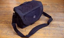 For Sale: Tamrac Express 7 Camera Bag Color: Black nylon with suede accents Model #3537 Messenger style camera bag, slim profile Used, excellent condition (no rips or tears) Internal Dimensions: 11 W x 4¼ D x 9 H External Dimensions: 13¼ W x 6 D x 9¾ H