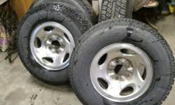 I have a set of four tires and rims off a Ford pickup.  Rims are a 5 bolt pattern with Cooper discoverer 245/75r16 load range E.  Tires used for one summer rims older but in near perfect condition