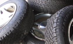 205 - 15 - 65R . tires like new. 2 snow tires & 2 front tires on aluminum rims off ford mustang 5 stud . call 5775730