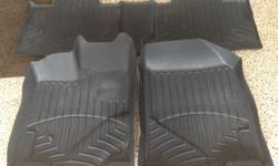 Custum made Weather Teck black floor mats for front and rear Ford Edge Model. In great condition! Bought new worth 250$