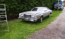 Make Ford Model Gran Torino Year 1976 Colour Silver kms 51000 Trans Automatic 76 ford elite 2 door, never saw winter, stored in doors 17 years, 3 minor tiny holes in left side body, excellent interior,glass,under body ,ect. needs paint, factory air,