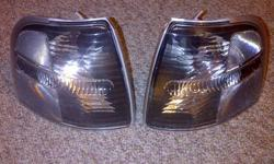 Brand new set of Smoked Chrome Corner lights that fit 2002 Ford Explorers and other years as well Ordered them online and when they showed up the corner of one was cracked.  pieces are in the box.  But I bought new ones $10.00