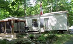 Three bedroom Cottager This Forest River Quailridge is 44ft with space for the whole family. It also has a gazebo. This one is located at Cedar Cove Resort White Lake Ontario on site K10