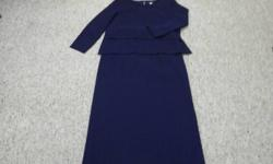 Very elegant navy 2-piece. Size 16.  Zahra brand.  Skirt is fully lined over semi-sheer baby pleated fabric. The pleats are tight and bounce back to original shape.  The Top is also fully lined except for the long sleeves which are the semi-sheer fabric.