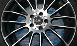 """Aftermarket 18"""" alloy rims off a 2009 Volkswagen Jetta. Low profile 225/40 R18 tires. Average condition because two of the four rims have some curb rash. Rims have summer tires on them and should be replaced."""