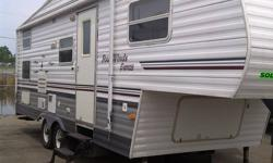 This 2004 white, burgandy and grey 5th wheel camper is in excellant condition.Can sleep up to 8 people. 2 bunks in rear. Awning in excellant condition. Lots of storage. Many new additions this year! 4 new tires with less than 5000 km, New deep cell