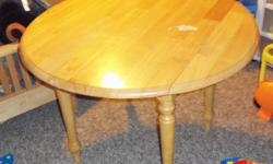 solid wood table,  has a mark on the top but can be refinished