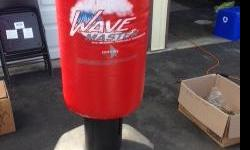 Free standing adjustable height punching bag. Good Condition.