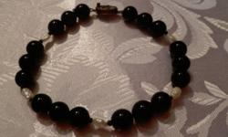 Freshwater Peal and Black Onyx/Hematite Bracelet. 8.5 inches 925 Sterling Silver catch. Non-smoking home.