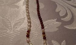 Freshwater Pearl Bracelet. 7+3/4 inches long. With Semi-Precious Red Stones. Purchased at Mappin's Jewellers. Non-smoking home.