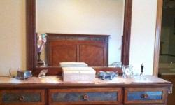 Large dresser with mirror, large tall dresser, two side tables and a bed frame. All match, sold together only. Looking to sell ASAP. Beautiful stone detail. Hardly used. This ad was posted with the Kijiji Classifieds app.