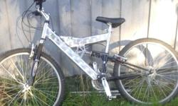 Welded aluminum frame. Entry level shocks front and rear. V brakes. Good for rider 5' tall or more.