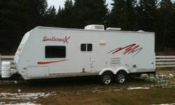 Rare find. Like new! Aluminum trailer with all options. Easy tow with Truck or SUV. Full queen size bed, bunk beds/large storage area. Full bath and kitchen. Sleeps 7 comfortably. Awning and indoor/outdoor stereo system. Oak interior easy care laminate