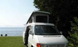 FURTHER REDUCED!  This immaculate 1997 VW pop top camper van is in excellent condition, with less than 1,000 kms on rebuilt transmission and new heavy-duty cargo tires.  The VR 6-Cylinder Engine with Automatic Transmission has never been driven in winter,
