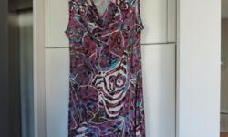 This is a versatile dress in fuschia/blue/white floral print by J. Martin. In excellent condition, rarely worn. Wear to office with blazer or pashmina for special occasions. Meet centrally downtown or Orleans. West end meet-up on wed evening only. p.s.