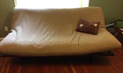 medium brown like new, coffey and tan cover that unzips for washing.