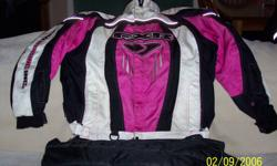 Ladies size 12 Black, Pink and White FXR Jacket with zip out liner 100.00 or best offer