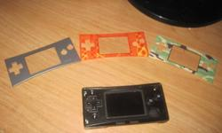 Theirs no scrathes what so ever, it still works perfectly. It comes with a case, a game (The Simpsons Road Rage), 3 things to go over the GameBoy and a charger. It has everything that came with it so thats why the price is high. PLease e-mail me if your
