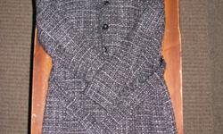 Classy tweed fall jacket with tie-belt in excellent condition. Coat ends just above knee, and has a satin liner for comfort. From a smoke-free home! Can make arrangements to deliver.