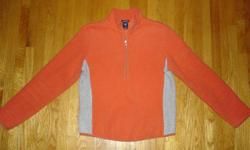 GAP Women's sweatshirt gently used in excellent condition. Pullover with a nice cozy collar and a zipper at the top. Size Medium two-tone orange with grey. Has a handy zipper pocket on the upper left arm. Still Available if you see the ad. Pickup only