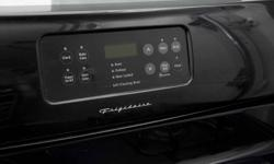 """This black 30"""" freestanding gas range features a self cleaning option and extra large viewing window.  Stovetop has 4 burners of equal size, with dials located on the front of range. This unit is approximately 2 years old and has seldom been used.  If you"""