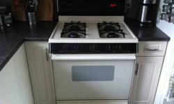Gas Range for sale, Good working condition. Recieved new Oven for wedding gift only reason selling this one.  $125.00 OBO   *Broiler in bottom drawer (usual with gas ranges) *Working clock *All 4 elements & Oven Working *Cream color with black accents.