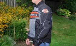 BOXING WEEK SPECIAL - $170 ONLY 1 AVAILABLE!!     Genuine Harley Davidson Men?s Switchback Motorcycle Jacket ? Size L    The real thing...not a fake....water resistant woven polyester jacket has textile outer panels that zip off to create a mesh jacket