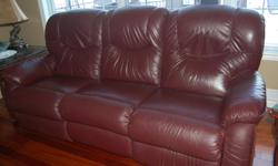 """Genuine La-Z-Boy leather recliner couch, burgundy, very good condition. Extremely comfortable. Smoke and pet-free home. Approx. 86""""W, 38""""D, 40""""H."""