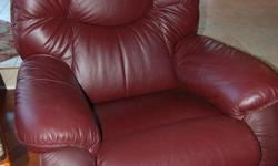 """Genuine La-Z-Boy leather rocker recliner chair, burgundy. Excellent condition and hardly used. Extremely comfortable. Smoke and pet-free home. Approx. 38""""W, 42""""D, 42""""H."""