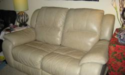 All genuine leather (no vinyl)  reclining sofa.  Good size for an apartment.  Two seater.  All mechanisms in great condition.  Non-smoking home.  Moving Sale.  No delivery and no assistance moving.