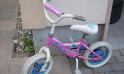 Girl's Bicycle with training wheels. 10 inch wheels Asking $20 Pick up in Orleans
