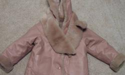 This coat is from Wilson?s leather and it?s in excellent condition.  It can be worn as a leather coat or faux fur coat.  It has a matching scarf with buttons to attach it to either side.  It?s pink, even though the colour is a little hard to see. Contact