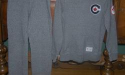 OLYMPIC HOODY & SWEATPANTS AUTHENTIC Purchased from The Bay This set is 100% cotton with wide elastic waistband and 1/2' cotton drawstring as well They are straight leg cut with all patched and emblems sewn on... Hoody has ribbed side panels for contour