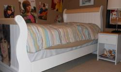 Complete girls bedroom set includes bedframe, matress, end table, desk, chair and armoir.