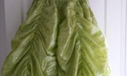 Size 12 formal gown. Off-the-shoulder sleeveless green gown with sequins embroidered on the fabric. Ties along the bodice. Green tulle along the bottom of the gown. Worn once for Grade 6 graduation. Originally paid $180.