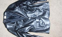 This leather look jacket goes great with the leather skirt that I just posted. I had to roll the sleeves up a lttle for it to fit just right but then it can be worn a little longer than the skirt. It is like new and makes your little girl look very