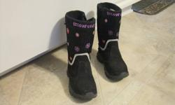 A pair of girls waterproof winter boots bought at Mark's Work Wearhouse. They were worn once. Paid $60.00 for them at Mark's Work Warehouse. Asking $40. They have a zipper on the inside to help slip on. I can deliver to Pembroke. Please email if