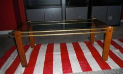 """Glass and brass coffee table. Approximately 17"""" x 40"""""""