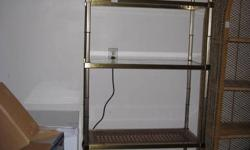 Shelving unit with 4 glass shelves and one wood/rattan shelf.  6 & 1/2 feet tall by 2 1/2 feet wide.  Call 519-676-6954 to view.