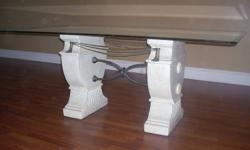 """Glass dining table for sale. In good condition. 72"""" long by 42"""" wide."""