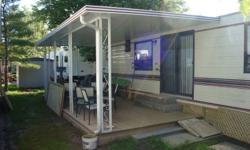 Glendale 36 foot trailer in very good condition. This trailer has two bedrooms and sleeps 6. Full kitchen with frig with freezer, stove, oven and microwave, and kitchen table with four chairs. Livingroom area has new hardwood floors, sofabed, chair and