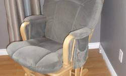 Glider rocking chair in excellent condition.  Has padded arm rests and side pockets for storage.    Soft, cozy fabric. From a smoke and pet free home.  Pick up in Elmira.