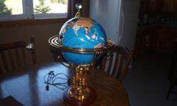 Unique Desk top Globe, made from precious stones, lights up and turns, great for that special someone for xmas, perfect condition. Asking $325.00  Phone 890-1186