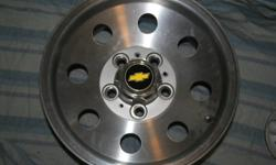 I have for sale a set of 4 aluminum gm truck/ van rims still in their original boxes from GM Austrailia   They are in mint condition, never mounted, never had a tire on them!   Come with center caps with stickers for GMC or Chev bowties.   They are