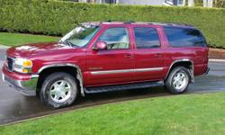 Make GMC Colour Burgandy Trans Automatic kms 216632 Great family vehicle. Large, good for storage and comfortable for travel. Not bad on gas, its a V-8 and has lots of power. No problems with the electronics, all the windows work and the 6 Cd stereo.