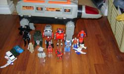 here are a bunch of old go bots and their giant fuel station robot base guy. the giant thing is flimsy,missing accessories and some fool ripped the light out of the head, i assume the bulb died and they tried to change it. anyways most the toys are